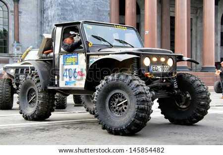 SAINT PETERSBURG, RUSSIA - MAY 25: Vansovics Edvins Juris's off-road vehicle Jeep CJ-7 No.406 competes at the annual Ladoga Trophy Challenge on May 25, 2013 in Saint Petersburg, Russia. - stock photo
