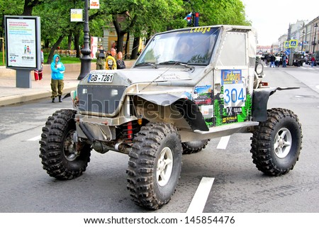 SAINT PETERSBURG, RUSSIA - MAY 25: Vilnis Zeiza's off-road vehicle Toyota Land Cruiser 80 No.304 competes at the annual Ladoga Trophy Challenge on May 25, 2013 in Saint Petersburg, Russia.