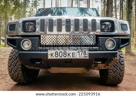 SAINT-PETERSBURG, RUSSIA - OCTOBER 12, 2014: black Hummer H2 car stands on dirty country road in Russia. Front view - stock photo