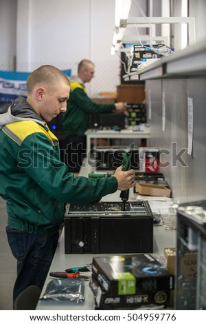 Saint-Petersburg, Russia - October 19, 2016: The production line of a small business computer assembly. Engineer a production line with a screwdriver in his hands