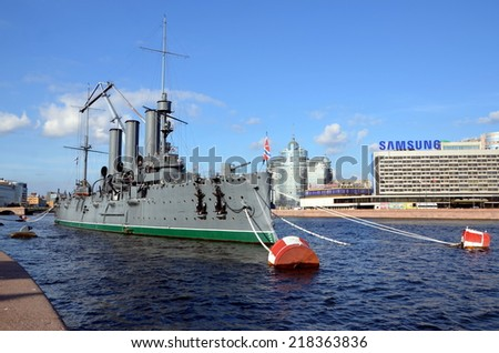 SAINT-PETERSBURG, RUSSIA, SEPTEMBER 18, 2014: Preparation of the cruiser Aurora to transportation for the restoration, St. Petersburg.  The ship will be sent for repairs on September 21, 2014