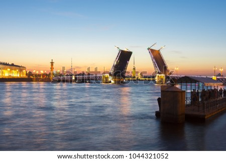 Saint Petersburg skyline at white nights with drawn Palace bridge, Peter and Paul fortress, Rostral columns and Kunstkamera, Russia