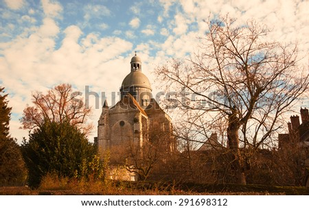 Saint-Quiriace Collegiate church in medieval town of Provins (Ile-de-France, France) in golden sunset sunlight. Medieval town of Provins is UNESCO World Heritage Site. - stock photo