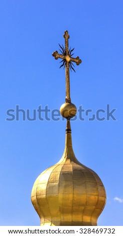 Saint Sophia Sofia Cathedral Spire Tower Cross Golden Dome Sofiyskaya Square Kiev Ukraine.  Saint Sophia is oldest Cathedral and Church in Kiev.  Saint Sofia was built by King Yaroslov Wise in 1037. - stock photo