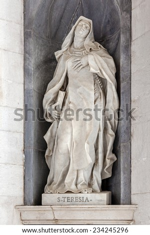 Saint Teresa of Avila. Italian Baroque sculpture - 18th century - in Mafra National Palace and Convent in Portugal. Baroque architecture - stock photo