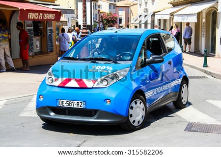 SAINT-TROPEZ, FRANCE - AUGUST 3, 2014: Electric police motor car Bollore Bluecar at the city street. - stock photo