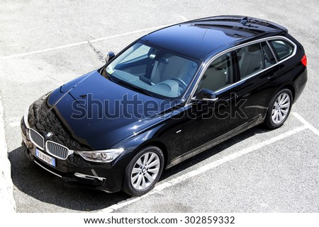 SAINT-TROPEZ, FRANCE - AUGUST 3, 2014: Motor car BMW F31 3-series at the city street. - stock photo