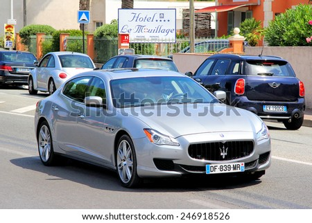 SAINT-TROPEZ, FRANCE - AUGUST 3, 2014: Silver luxury sedan Maserati Quattroporte at the city street. - stock photo