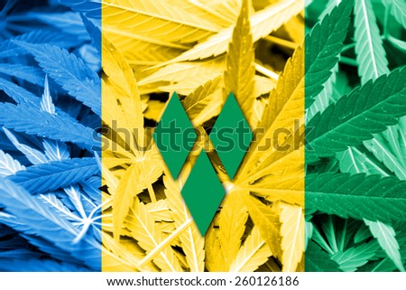 Saint Vincent and The Grenadines Flag on cannabis background. Drug policy. Legalization of marijuana - stock photo
