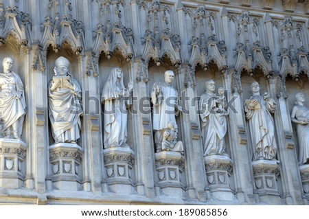 Saints carved into exterior of Westminster Abbey, London - stock photo
