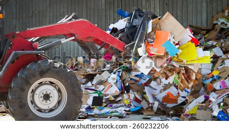 Sakarya, Turkey - June 2, 2012: Various colored cardboard and papers packed for recycling stored in recycling facility. Close up photo. - stock photo