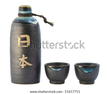 Sake bottle and two cups. - stock photo