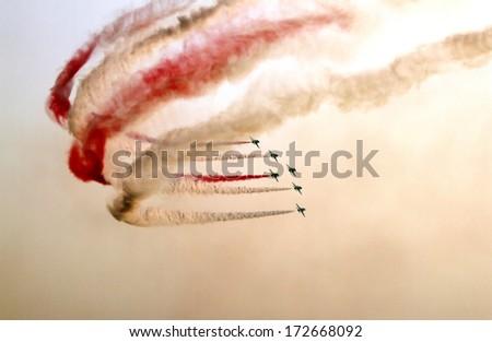 SAKHIR AIRBASE, BAHRAIN - JANUARY 16: Flying display and aerobatic show of Saudi Hawks Display Team in Bahrain International Airshow at Sakhir Airbase, Bahrain on 16 January, 2014  - stock photo
