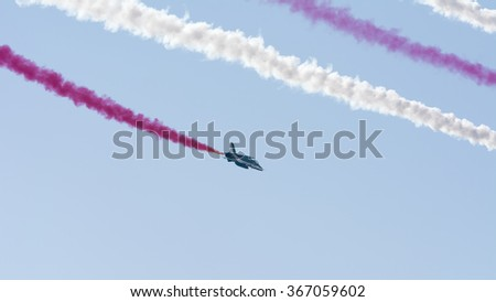 SAKHIR AIRBASE, BAHRAIN - JANUARY 23: Flying display and aerobatic show of Saudi Hawks display team in Bahrain International Airshow at Sakhir Airbase, Bahrain on 23 January, 2016
