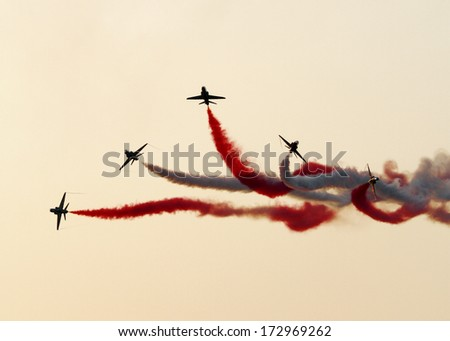 SAKHIR AIRBASE, BAHRAIN - JANUARY 16: Flying display and aerobatic show of Saudi Hawks in Bahrain International Airshow at Sakhir Airbase, Bahrain on 16 January, 2014  - stock photo