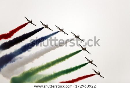 SAKHIR AIRBASE, BAHRAIN - JANUARY 18: Flying display and aerobatic show of The Al Fursan UAE display team in Bahrain International Airshow at Sakhir Airbase, Bahrain on 18 January, 2014  - stock photo