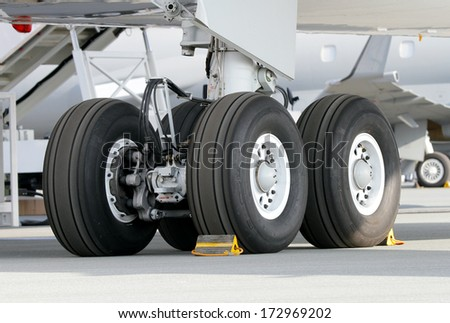 SAKHIR AIRBASE, BAHRAIN - JANUARY 16: Wheel assembly of a static displayed aircraft in Bahrain International Airshow at Sakhir Airbase, Bahrain on 16 January, 2014