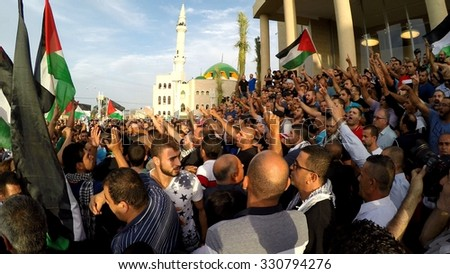 SAKHNIN, ISRAEL- OCTOBER 13: Havoc among Arab Israeli Muslim activists during anti Israel protest in demand liberation of Al Aqsa mosque and occupied territories - stock photo