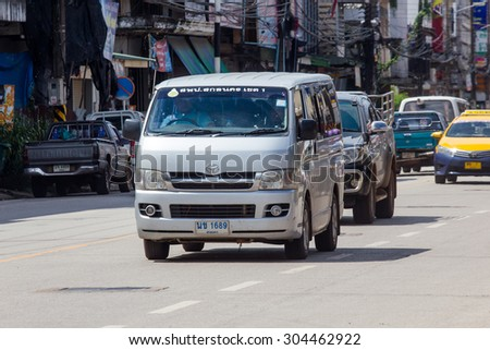 SAKON NAKHON, THAILAND -August 9 2015 : Traffic through the city streets in the afternoon. Photo at downtown Sakon