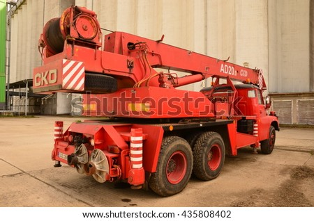 SAKVICE, THE CZECH REPUBLIC -  MAY 31, 2016: Red mobile crane Tatra AD 20. The truck-mounted crane AD 20 is determined for building and assembly works also in heavy terrain. The truck was made in 1978 - stock photo