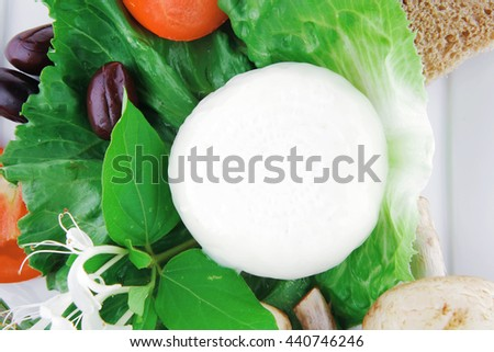 salad and low fat cheese on white plate - stock photo