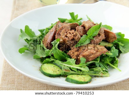 salad appetizer with chicken liver, arugula and cucumber