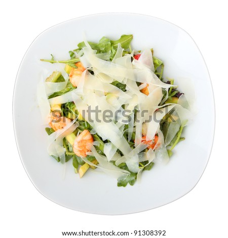 salad arugula with shrimps and cheese on white isolated dish. Top view. - stock photo