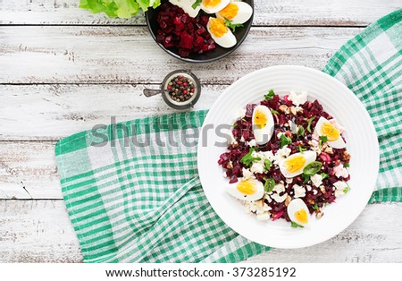 Salad baked beets, feta cheese, eggs, and walnuts. Top view - stock photo