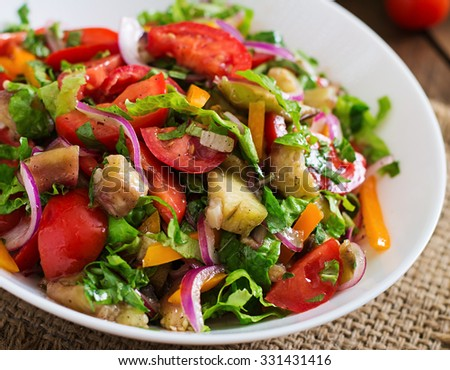 Salad baked eggplant and fresh tomatoes - stock photo