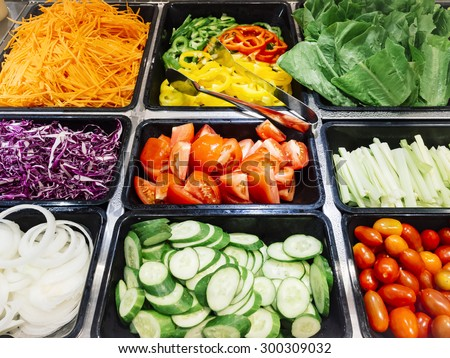 Salad Bar Fresh Vegetables sliced Tomato Carrot Celery Cucumber Cherry tomato - stock photo