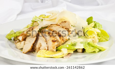 Salad Caesar with pieces of chicken and parmesan - stock photo