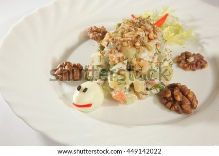 salad designed as bugs on plate - stock photo