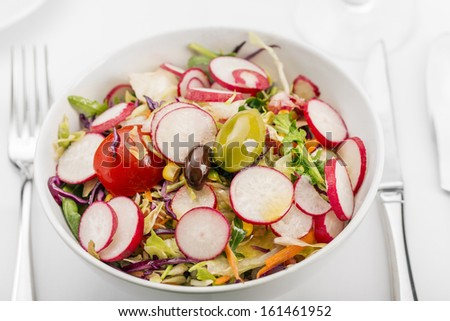 Salad/Fresh vitamin salad. Close up of mixed vegetable salad. The grain and texture added. Selective focus. Very shallow Depth of Field, for soft background. - stock photo