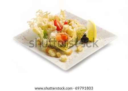 Salad from a salmon, cheese, tomatoes, olives, a lemon on a light plate on a white background, a shot horizontal - stock photo