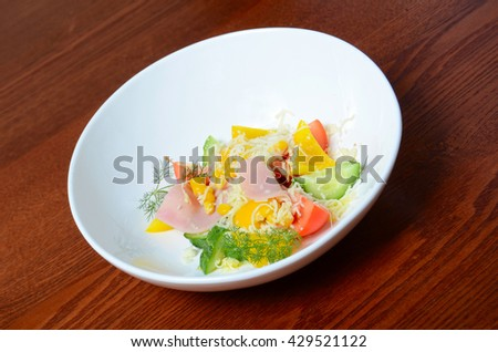Salad from fresh vegetables with a ham