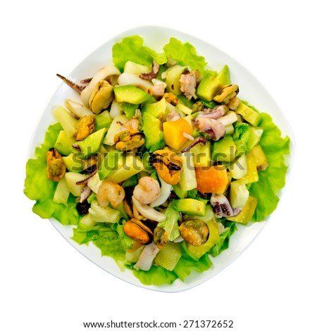 Salad from shrimps, octopus, mussels and calamari with avocado, lettuce, pineapple in plate isolated on white background top - stock photo