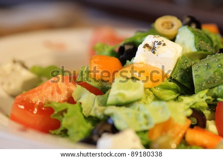 "Salad ""Greek"" in  white plate"