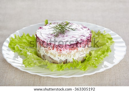 """Salad """"Herring under a fur coat""""on a white plate - stock photo"""