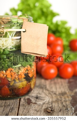 Salad in a jar on wooden table