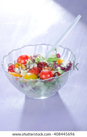 Salad in a small bowl as a snack and diet meal, in selective sharpness taken