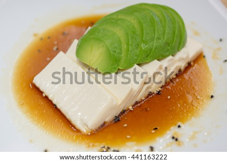 Salad in Asian Food style with tofu cheese and avocado in japanese sauce. Avocado with tofu and Japanese sauce. fusion food. Avocado Salad slice on tofu. Design to service in  japanese restaurant - stock photo