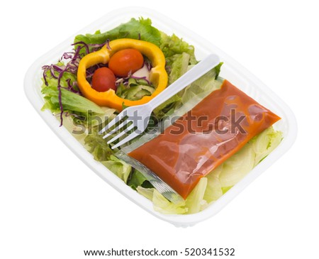 Salad in plastic container isolated on white background