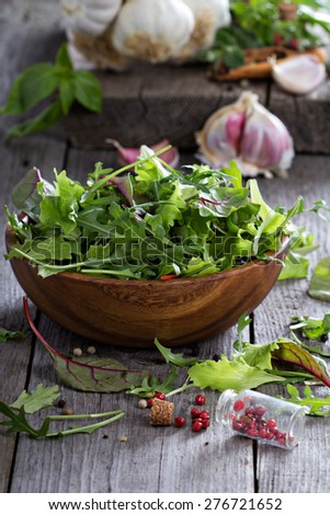 Salad leaves fresh and green in a wooden bowl