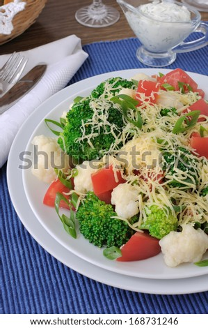 Salad of cauliflower and broccoli, tomatoes and cheese