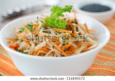 Salad of cauliflower, carrots and red peppers closeup - stock photo