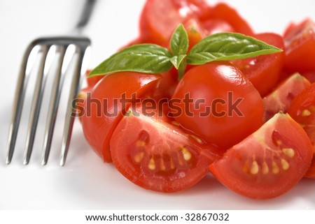 Salad of cherry tomato with a fork - stock photo