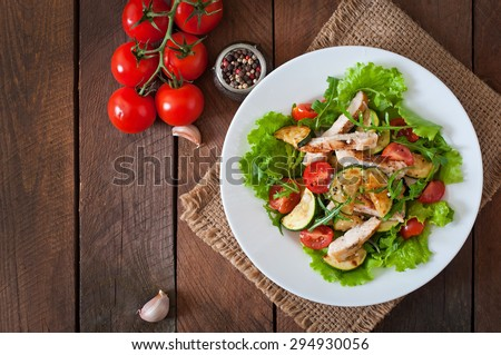Salad of chicken breast with zucchini and cherry tomatoes. Top view