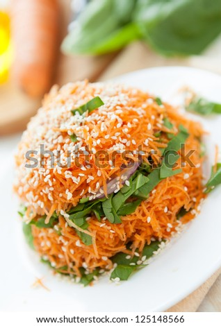 Salad of fresh carrots and spinach, fresh food - stock photo