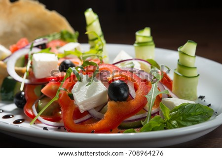 salad of peppers, olives, cheese, mozzarella, sauce, cucumber, with a beautiful presentation