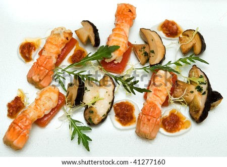 salad of porcini mushrooms and grilled lobster - stock photo
